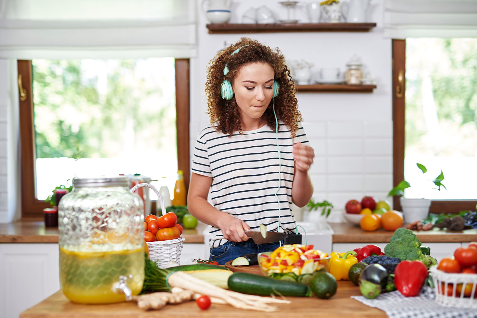 happy-woman-cooking-in-kitchen