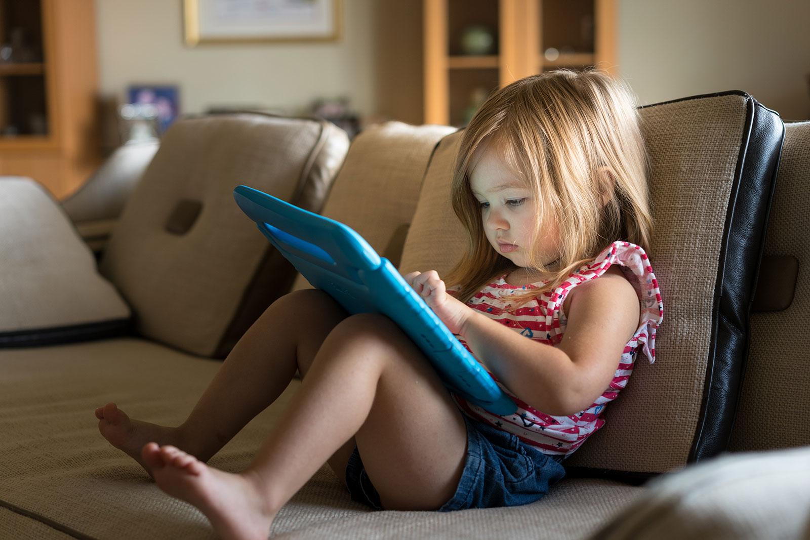 little-girl-reading-tablet