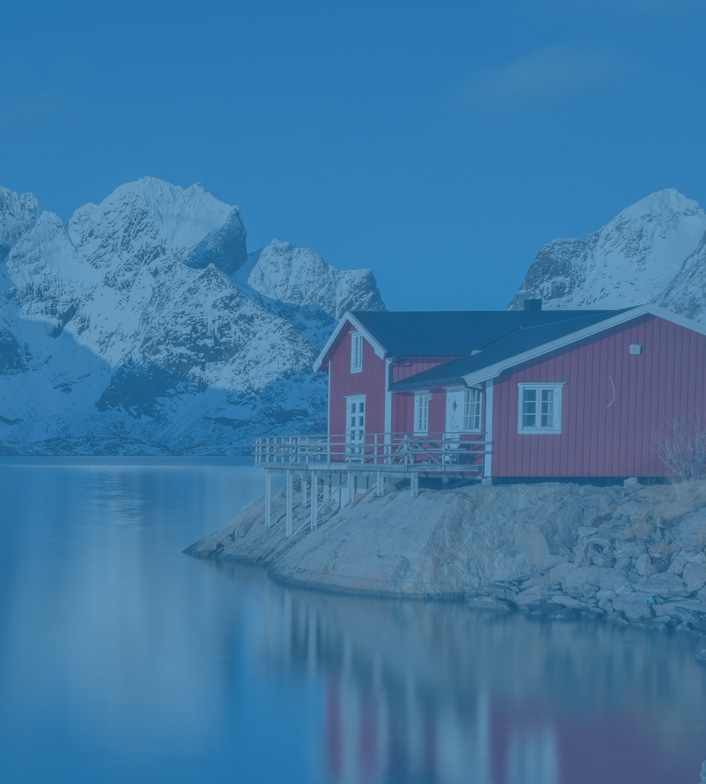 Red house on a quaint Norwegian lake