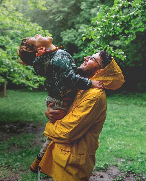 Dad & son in the rain